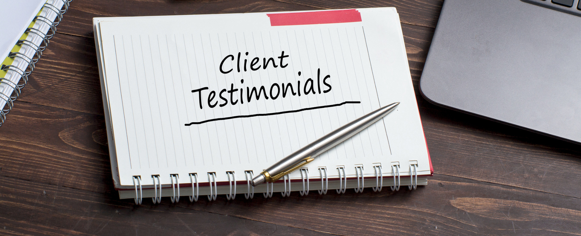 Note pad with clients testimonials written across the page