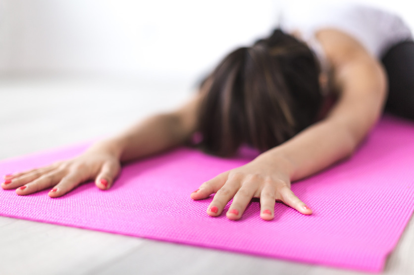 Lady doing yoga - Does working out make a difference in hair system attachments?